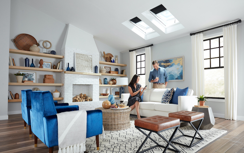 Couple using VELUX ACTIVE to operate their Fresh Air Skylights