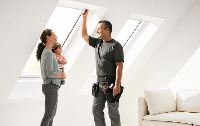 Image of a Skylight Installer standing with Homeowner