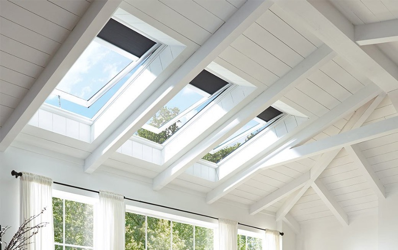 VELUX venting skylights with blue blinds