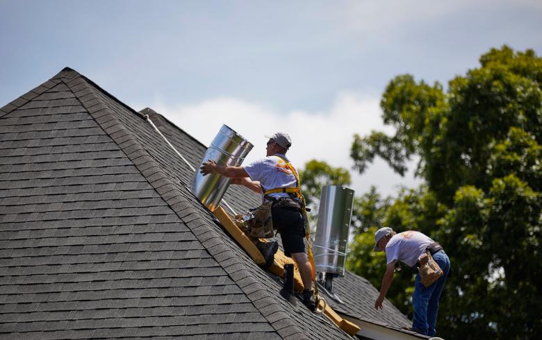 Roofers installing Sun Tunnel Skylights